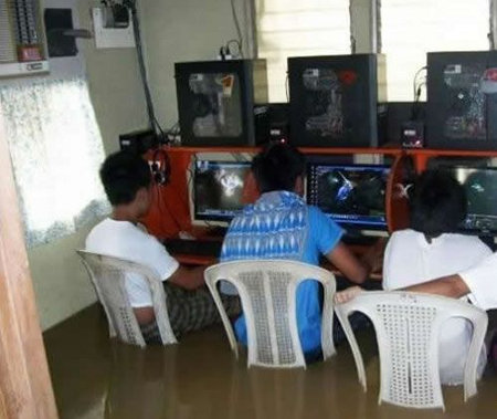 Internet cafe flooded somewhere in the Philippines maybe